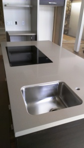 Countertops slcmidcenturygreen - Kitchen island with cooktop and prep sink ...